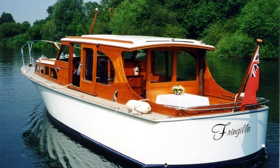 Experience Cruising Aboard A 1960 Van Lent Motor Yacht For 12 Person In Windsor, England