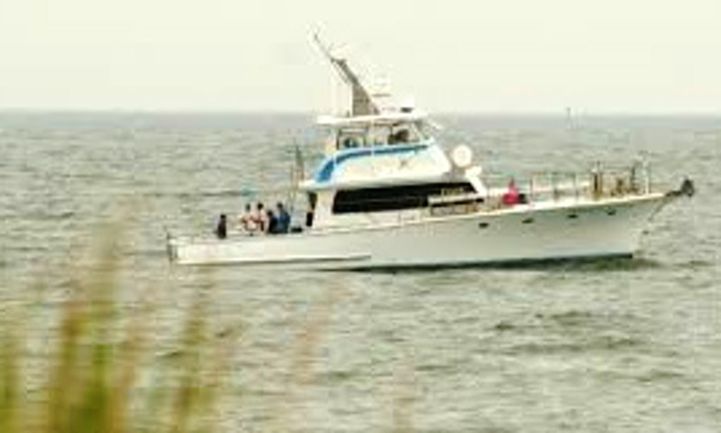 Fishing charter on 52ft pirate king two center console for Fishing charters lewes de