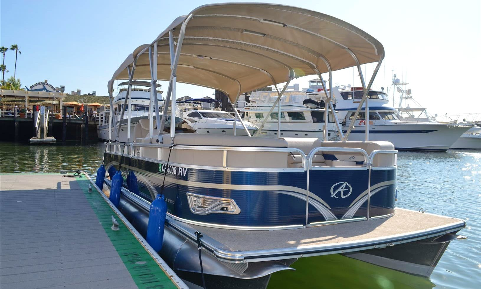 Rent this 21ft Deluxe Avalon Pontoon in Newport Beach, California