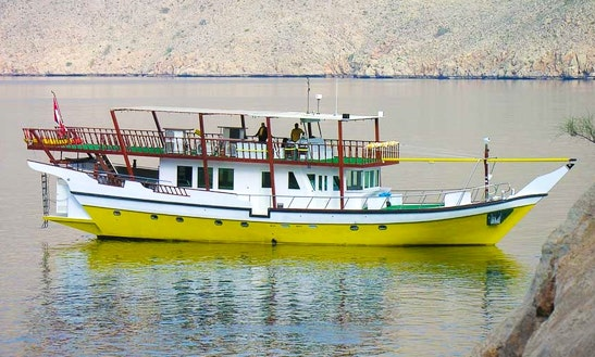 Yellow Dhow  In Dibba Oman