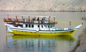 Yellow Dhow  in Dibba Oman