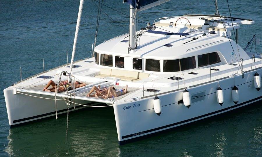 "LAGOON 440 Cruising Catamaran ""Carpe Diem"" Trips in Santorini, Greece"