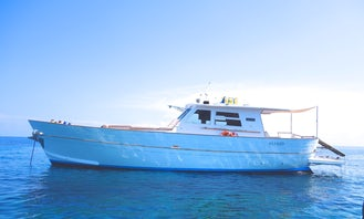 Captained 50 ft Motor Yacht Charter for Up to 8 People in Santa Marina Salina, Italy