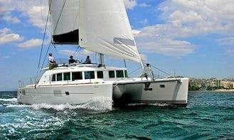 All Inclusive Thematic Cruise Day Excursion on Lagoon 440 Cruising Catamaran in Santorini