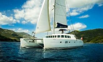 Private Cruise for up to 12 people aboard Lagoon 500 Catamaran in Santorini, Greece