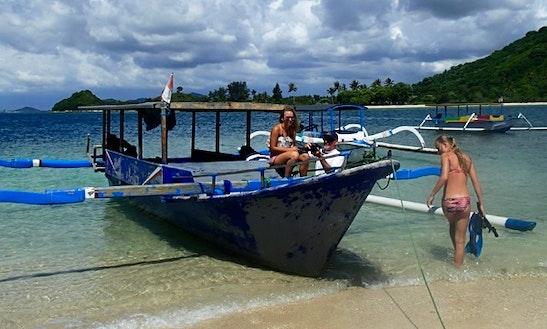 Outrigger Boat Snorkeling Tour In Gili Nanggu