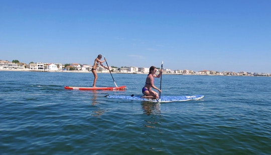 Take A Cool Paddleboard Ride On Fantastic Beach In Palavas-les-flots, France