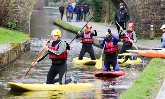Exhilarating Paddleboarding Adventure With Friends In Llangollen, Wales