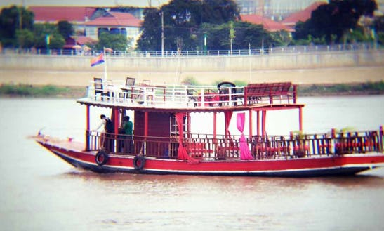 Sightseeing Trip Aboard A Traditional Boat In Phnom Penh, Cambodia
