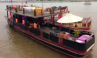 Guided River Adventure Trip aboard a Wooden Cambodian Boat!