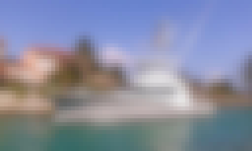 """Poverty Sucks"" Hatteras Fishing Charter in Puerto Aventuras"