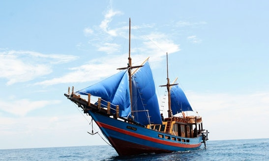 Take A Voyage Aboard A Sailing Schooner In Komodo, Indonesia