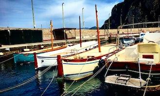 Sunset Cruises on Wooden Boat in Capri, Italy