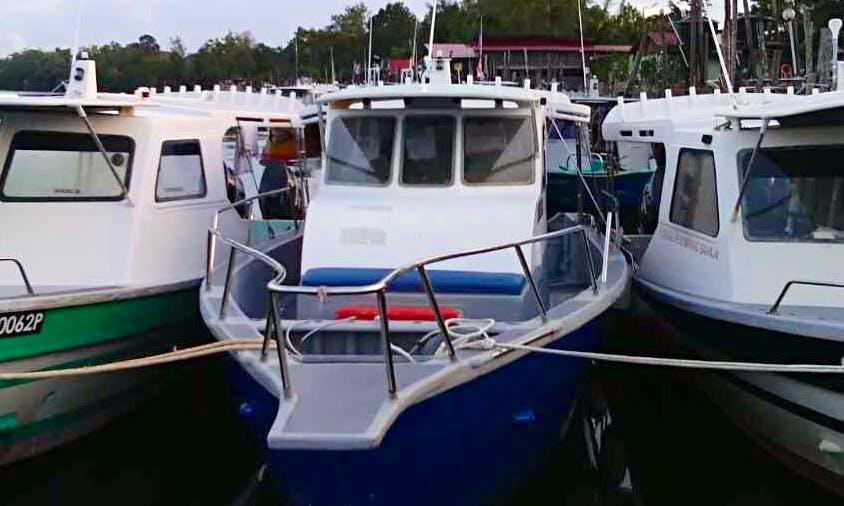 Enjoy Fishing in Kuala Rompin, Malaysia on 32' Cuddy Cabin