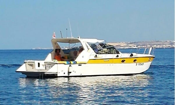 Motor Yacht Cruising in Blue Lagoon, Comino and Gozo, Malta