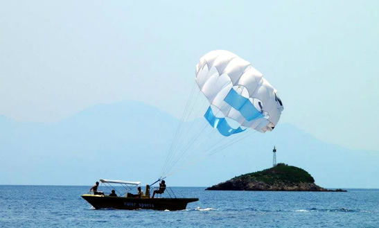 Enjoy Parasailing At Ahladies Beach, Sporades