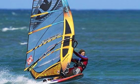 Enjoy Windsurfing Courses And Rentals In Lagoa De Albufeira, Portugal
