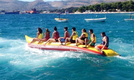 Enjoy Banana Rides At Okrug Gornji Beach In Dalmatinska