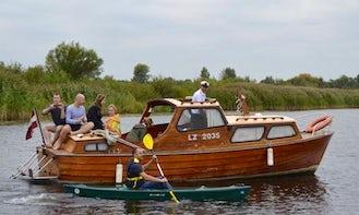 Charter a Wooden Motor Yacht in Jelgava, Latvia