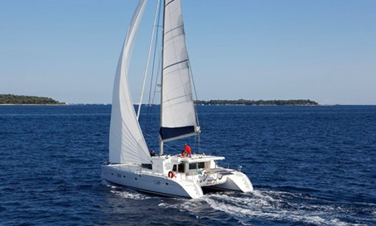 Charter 50' Lagoon Cruising Catamaran In Portiglioni Gr, Italy