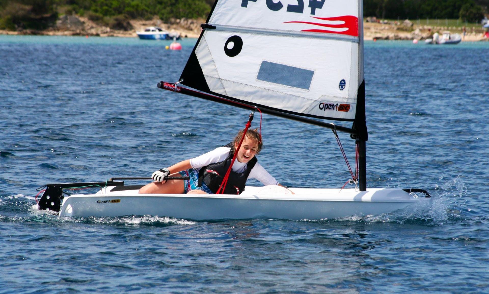 Rent O'pen Bic Sailing Dinghy in Porto Pollo, Sardegna