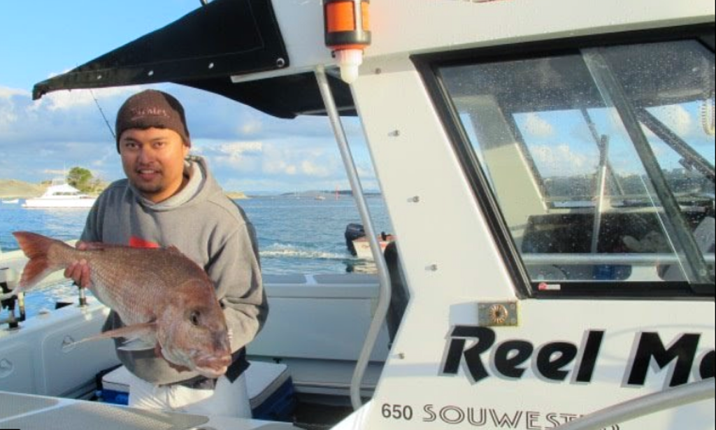 Enjoy fishing in mangawhai heads northland with captain for Captain tonys fishing