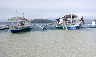 """Charter the """"Oxy 2"""" Traditional Boat in Bais City, Philippines For 13 People"""