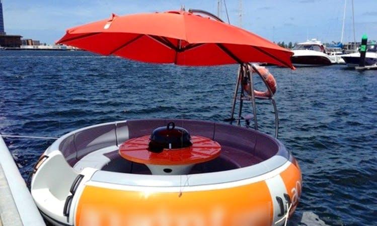 Enjoy Aqua Donut Boat in Docklands, Victoria