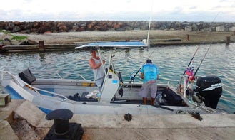 Fishing in Avarua District, Cook Islands on 19' Hardy Center Console