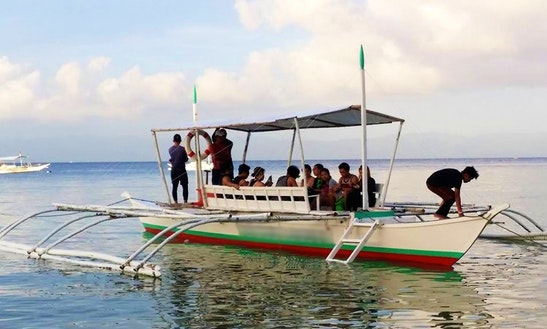 Explore Moalboal, Philippines On A Traditional Boat For Up To 15 People
