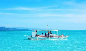 Traditional Paraw Boat Tours in Bais City, Philippines