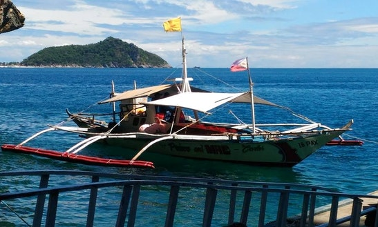 Charter A Traditional Boat In Carles, Philippines