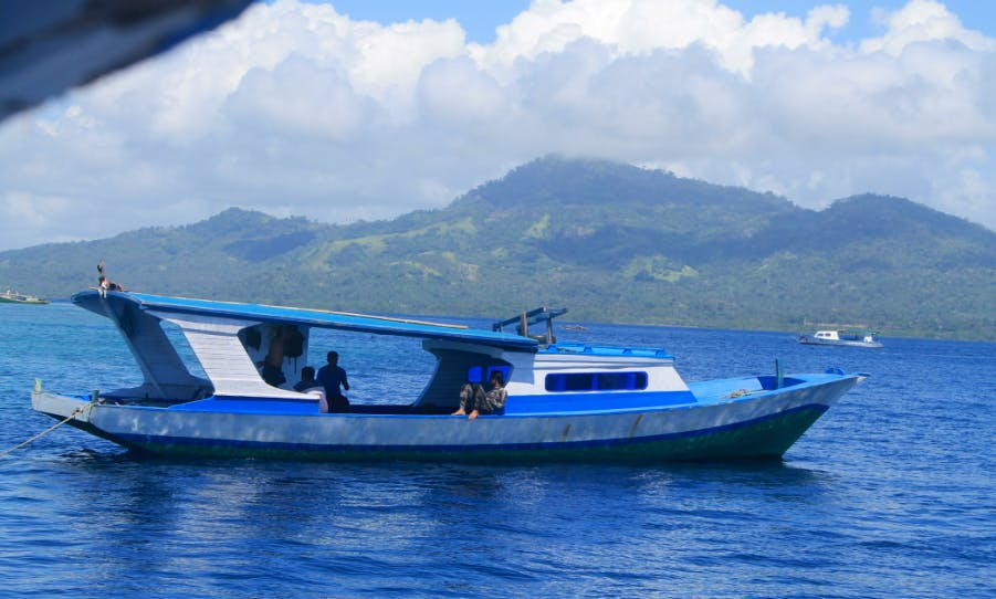Book this deck boat rental for trips to Bunaken & Siladen island