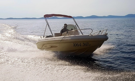 Experience The Water Of Mali Lošinj, Croatia Rent A Deck Boat!
