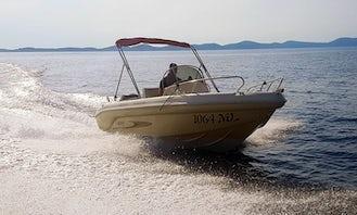 Experience the water of Mali Lošinj, Croatia Rent a Deck Boat!