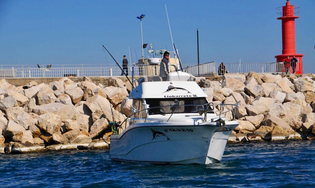Enjoy Fishing in Cambrils, Spain on Llobarrete II Cuddy Cabin