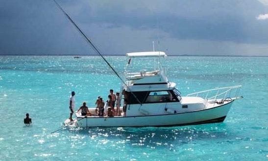 Enjoy Fishing In West Bay, Cayman Islands On 34' Magic Hook Sports Fisherman