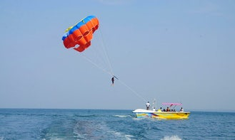 Have Fun and Laughs on a Parasailing Ride in Malvan, India