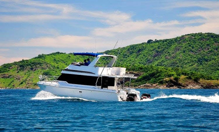 """Chloe"" Power Cat 3800 Flybridge Charter in Tambon Mai Khao"