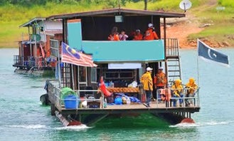 See Wildlife and Waterfalls on a Houseboat Charter in Malaysia