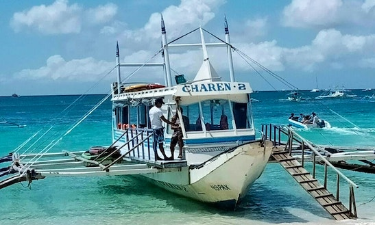 Charter A Traditional Boat With A Friendly Guide In Malay, Philippines