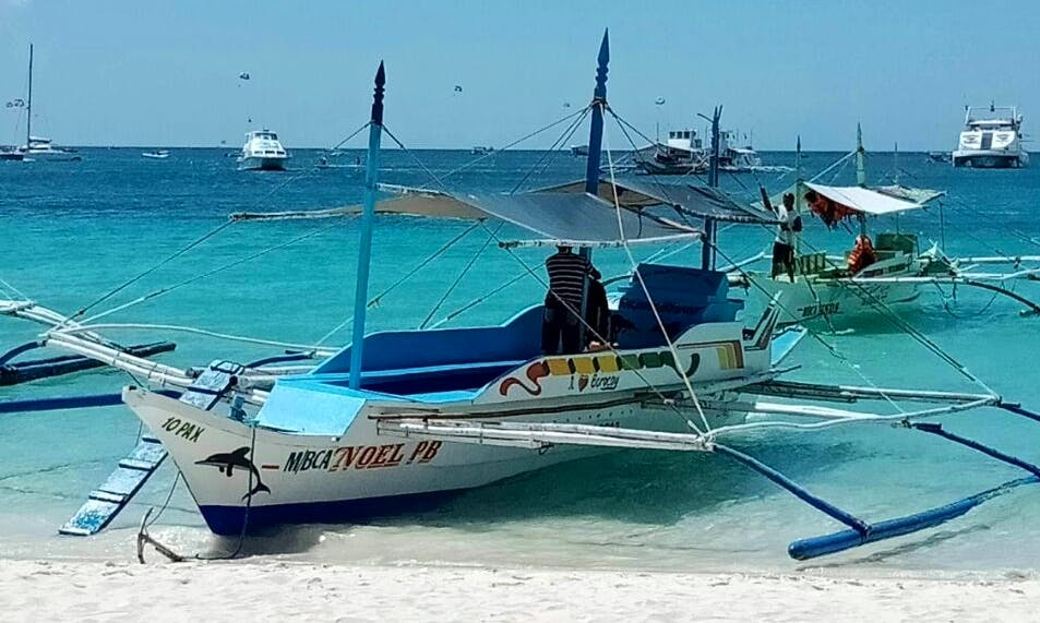 Explore the beaches of Malay, Philippines on a Traditional Boat