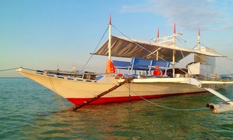 Charter a Traditional Pinoy Boat to Cruise the Mindoro Strait, Philippines