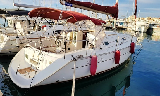 Charter 10 Person Oceanis Clipper 311 Sailboat In Catalunya, Spain