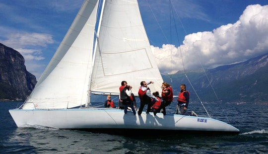 Sailing On Lake Garda On 33ft Asso 99 Sailboat
