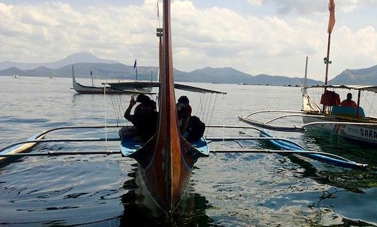 See The Philippine's Majestic Mountains From A Traditional Boat