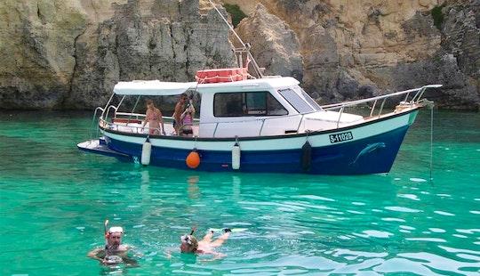 Skipperd Boat Trips And Private Charter On 27' Delfino Boat In Xlendi Bay, Munxar