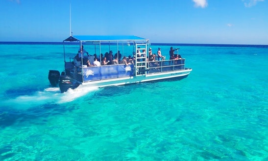 Charter Blue Horizons Pontoon Boat In West Bay, Cayman Islands