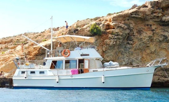 Explore The Waters Of Il-gżira, Malta On This Beautiful 42' Grand Banks Motor Yacht