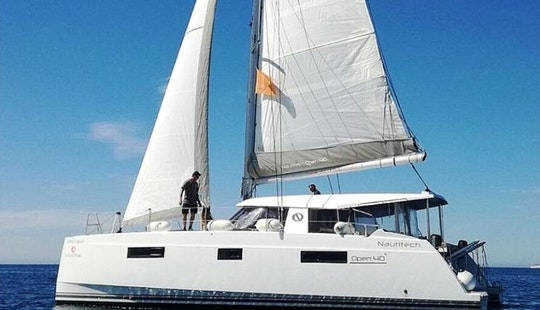 Experience The Thrill Of Sailing On This Beautiful Nautitech 40 Open Catamaran In Palma, Spain